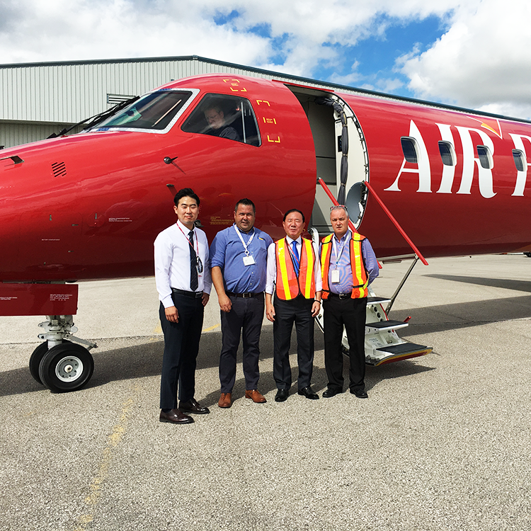 blair and greg delivering red embraer erj145 to client