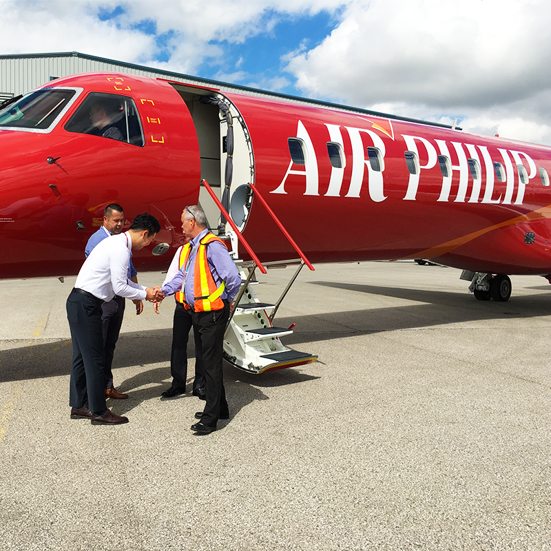 new united goderich with client outside red embraer erj145