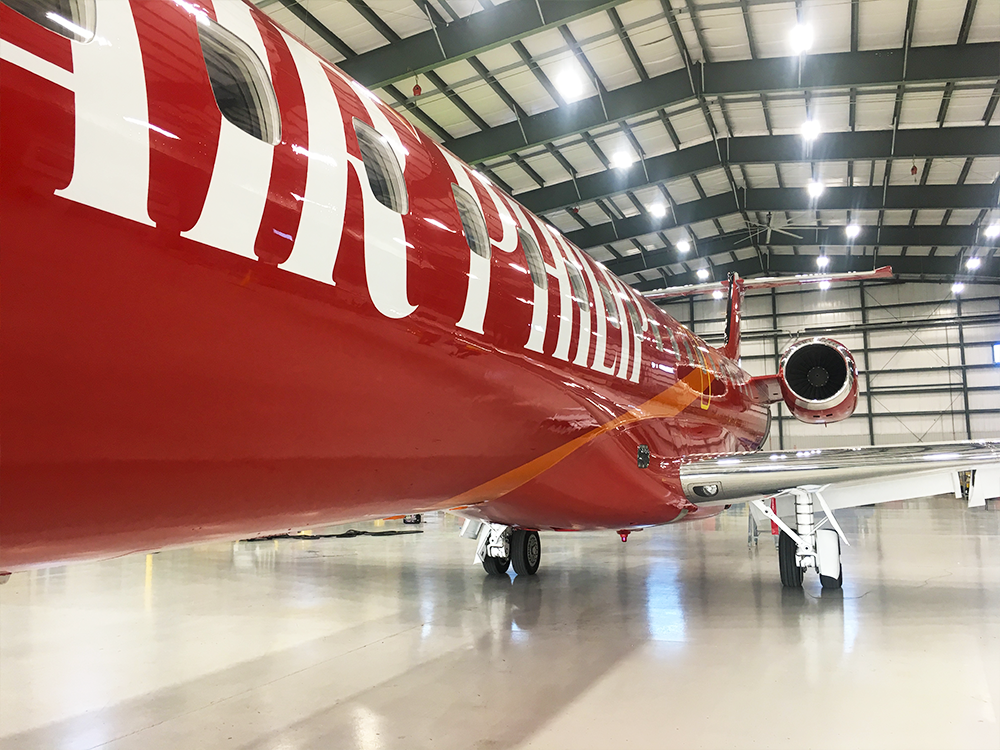 close up of red exterior paint with white text for embraer erj145